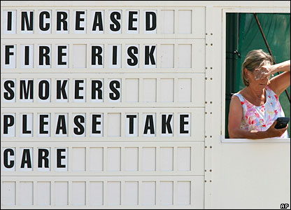 Increased fire risk sign on scoreboard at the Open golf at Hoylake