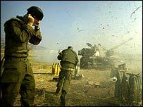 Israeli soldiers firing artillery gun