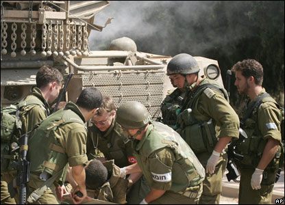 An Israeli soldier wounded in frontline fighting is evacuated to northern Israeli town of Avivim