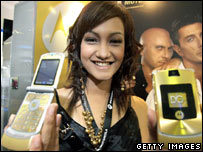 Model shows off Motorola phones