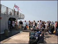 Evacuees climb aboard HMS York