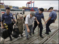 An elderly man boards HMS Bulwark in Beirut