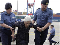 An elderly person boards HMS Bulwark in Beirut