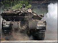 An Israeli tank manoeuvres in the Israeli area of Avivim, on its border with Lebanon