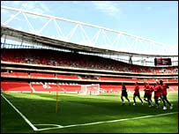 Arsenal's squad train at their new home - the Emirates Stadium