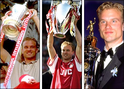 Dennis Bergkamp celebrates winning the FA Cup, the Premiership and the Player of the Year Award in 1998