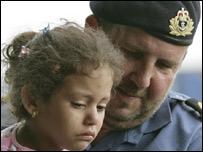 A girl evacuates Beirut