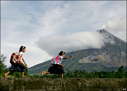 Children on their way to school with the volcano in the background