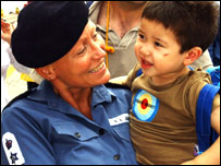Naval officer with little boy