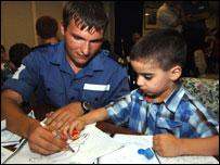 Sailor draws with boy