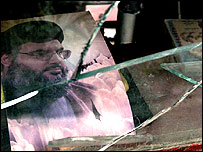 Portrait of Hezbollah leader Hassan Nasrallah in remains of destroyed building