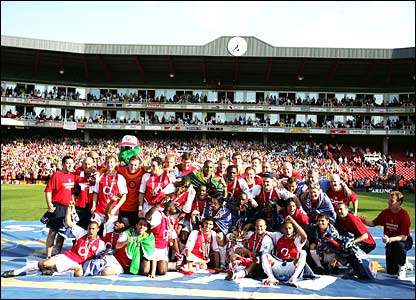 Arsenal celebrate winning the title and going through the season unbeaten
