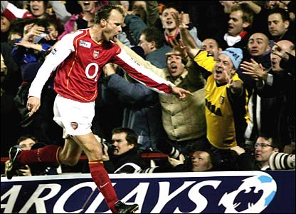 Dennis Bergkamp celebrates another goal with the Arsenal faithful