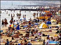 Crowded beach in heatwave