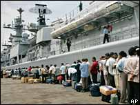 Indian nationals queuing in front of the boat INS Mumbai in Beirut