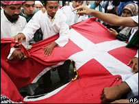 Protesters in Jakarta burn the Danish flag on 3 February 2006