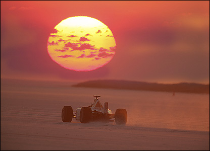 The Honda F1 car on Bonneville Salt Flats with the sun rising in the background