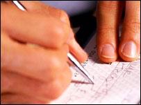 Man signing cheque, Eyewire