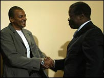 Bernard Lama shaking hands with Alfred Sambu, the chairman of the Kenya Football Federation