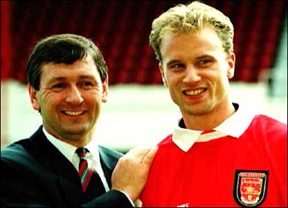 Bruce Rioch flaunts his new signing in front of the press in the summer of 1995