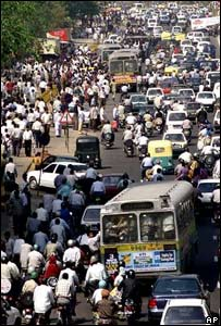 Crowds of people and traffic in New Delhi
