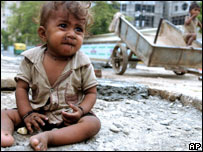 A poor child sits on the street in New Delhi (Photo: Manpreet Romana/AFP/Getty Images)
