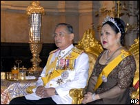 King Bhumibol with Queen Sirikit seated on thrones