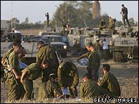 Israeli troops on the border with Gaza on 11 July