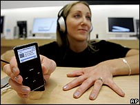 Woman listening to Apple iPod nano