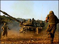 Israeli troops fire tank shells near Lebanese border