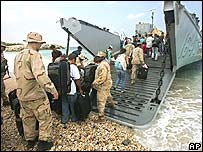 Americans board a landing utility craft as they evacuate from a beach in Beirut