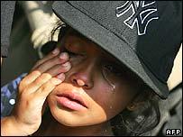US child cries as she leaves Beirut, Lebanon