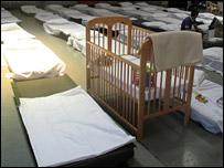 A cot and beds inside a hangar at RAF Akrotiri