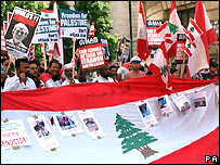 Protesters gather in central London with Lebanese flags