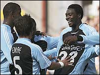 Shola Ameobi (right) is congratulated by his team-mates after his opener in Norway