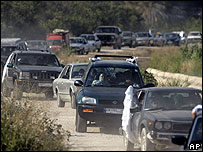 Lebanese flee north from the southern village of Adloun, near Tyre