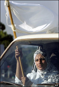 Woman with white flag near Tyre