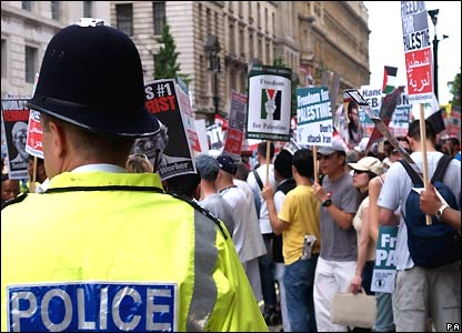 Protesters gather with placards in London