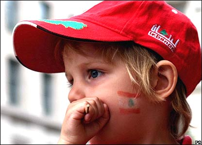 Child with Lebanese flag painted on her face in London