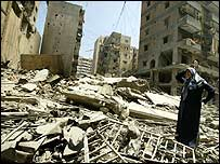 Woman stands in rubble in Beirut (22 July)