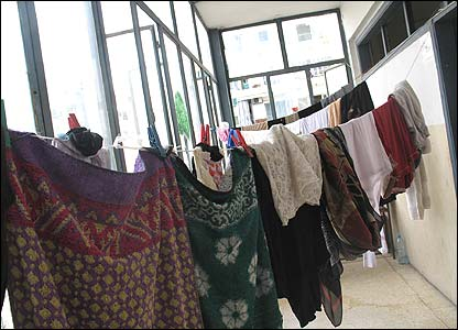 Washing hangs on a makeshift line in a public building housing refugees in Beirut, Lebanon