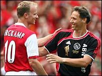 Dennis Bergkamp shakes hands with Marco van Basten