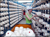 Woman working in yarn factory in China