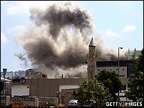 Smoke rises seconds after a Hezbollah missile strike in the northern Israeli city of Haifa