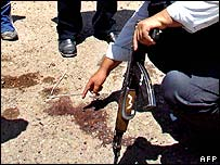 A patch of blood shows the spot where Saddam Hussein's lawyer Khamis al-Obeidi was shot dead in June