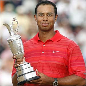 Tiger Woods lifts the claret jug
