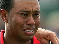 Tiger Woods breaks down in tears after knocking in his putt on the final green