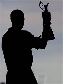 Tiger Woods holds the Claret Jug aloft