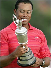 Tiger Woods looks at the Claret Jug after winning it for a third time