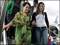 Gloria Arroyo (left) greets Filipino evacuees returning from Lebanon on 23 July
